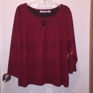 Sparkly red blouse.